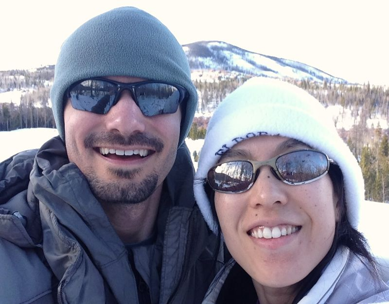 Benjamin Patch and Leslie Wei hiking the snow covered Colorado Rockies.