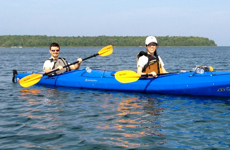 Benjamin Patch and Leslie Wei paddling across Eagle Harbor, Wisconsin.
